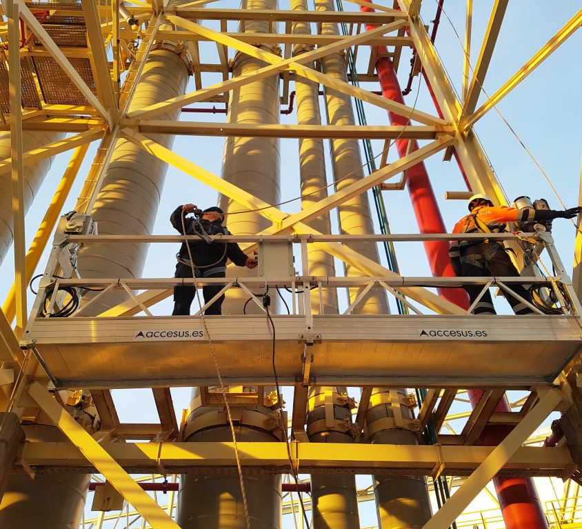 Suspended platform for painting maintenance at LNG tank tower racks